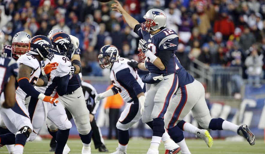 New England Patriots quarterback Tom Brady passes against the Denver Broncos in the first half of an NFL football game on Sunday, Nov. 2, 2014, in Foxborough, Mass. (AP Photo/Elise Amendola)