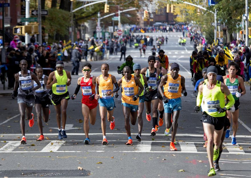 Runners in the men's division move through the borough of Brooklyn during the New York City Marathon in New York Sunday, Nov. 2, 2014. (AP Photo/Craig Ruttle)