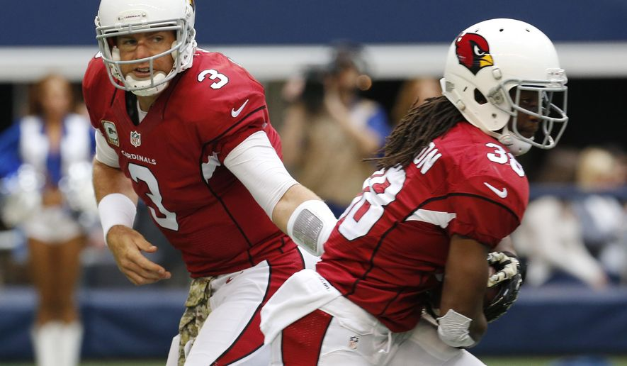 Arizona Cardinals quarterback Carson Palmer (3) hands the ball to running back Andre Ellington (38) during the first half of an NFL football game against the Dallas Cowboys Sunday, Nov. 2, 2014, in Arlington, Texas. (AP Photo/Sue Ogrocki)