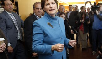 Sen. Jeanne Shaheen, D-N.H. talks to supporters during a campaign stop, at the cafe inside Gibson's Bookstore, Monday, Nov. 3, 2014 in Concord, N.H. (AP Photo/Jim Cole)