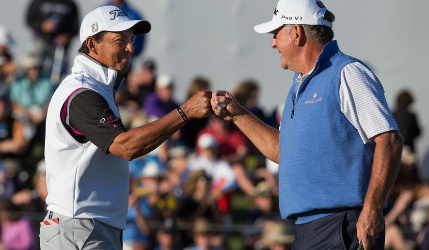 Tom Pernice Jr., of Nashville, Tenn., left, and Jay Haas, from Greenville, S.C., bump fists during the final playoff at the Charles Schwab Championship at Desert Mountain, Sunday, Nov. 2, 2014 in Scottsdale, Ariz. (AP Photo/The Arizona Republic, Dominic Valente)  MARICOPA COUNTY OUT; MAGS OUT; NO SALES
