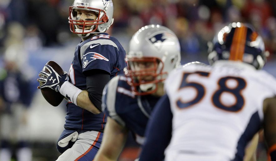 New England Patriots quarterback Tom Brady, looks for a receiver against the rush by Denver Broncos outside linebacker Von Miller (58) in the first half of an NFL football game on Sunday, Nov. 2, 2014, in Foxborough, Mass. (AP Photo/Stephan Savoia)