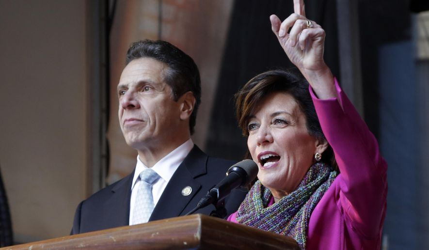 Kathy Hochul, right, the Democratic candidate for Lt. Gov., and New York incumbent Democratic Gov. Andrew Cuomo campaign in New York's Times Square, Monday, Nov. 3, 2014. The election is Tuesday. (AP Photo/Mark Lennihan) ** FILE **