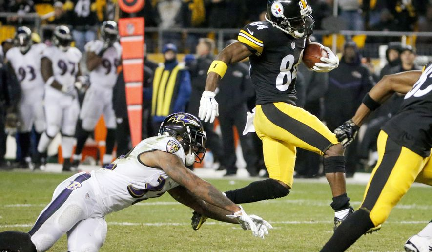 Pittsburgh Steelers wide receiver Antonio Brown (84) gets by Baltimore Ravens defensive back Will Hill (33) on his way to a touchdown in the fourth quarter of an NFL football game, Sunday, Nov. 2, 2014, in Pittsburgh. (AP Photo/Gene Puskar)