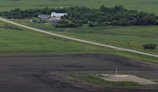 This June 24, 2014, file photo, shows an ICBM launch site located among fields and farms in the countryside outside Minot, N.D. The Air Force on Monday, Nov. 3, 2014, fired two more nuclear commanders and disciplined a third. The actions were confirmed to the Associated Press in response to an AP inquiry about an internal Air Force investigation of two commanders at the 91st Missile Wing at Minot Air Force Base, N.D., which also is responsible for 150 Minuteman 3 missiles. (Associated Press)