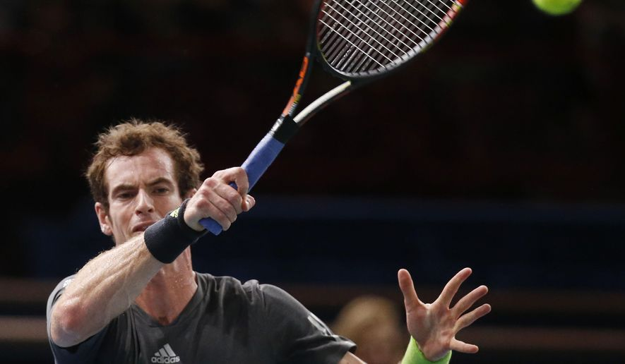 Andy Murray of Britain, returns the ball to Novak Djokovic of Serbia during their quarterfinal match at the ATP World Tour Masters tennis tournament at Bercy stadium in Paris, France, Friday, Oct. 31, 2014. (AP Photo/Michel Euler)