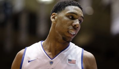 In this Saturday, Oct. 25, 2014, photo, Duke's Jahlil Okafor reacts during an NCAA college basketball scrimmage at Cameron Indoor Stadium in Durham, N.C.  With a lineup stacked with four blue-chip freshmen talented enough to jump to the NBA after one year, these Blue Devils look an awful lot like some recent Kentucky teams. (AP Photo/Gerry Broome)