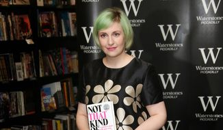 "In this Oct. 29, 2014, file photo, U.S. actress Lena Dunham holds her memoir, ""Not That Kind Of Girl,"" ahead of a book signing at Waterstones book shop, Piccadilly in central London. (Photo by Joel Ryan/Invision/AP, File)"