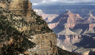 This Oct. 22, 2012 file photo shows a view from the South Rim of the Grand Canyon National Park in Arizona.  Grand Canyon officials say hotels, mule rides and restaurants at the South Rim will remain open to millions of visitors once they award a temporary concessions contract. A new 15-year contract worth up to $1 billion for services at the South Rim is up for bid for a third time after previous bids didn't meet the park's terms. (AP Photo/Rick Bowmer, file)File -