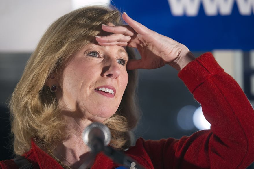 Republican Congressional candidate Barbara Comstock looks for family members in the audience while speaking at a Get Out the Vote rally campaign office parking lot in Sterling, Va., Monday, Nov. 3, 2014. Comstock is running for the seat that will be vacated by retiring Rep. Frank Wolf, R-Va. (AP Photo/Cliff Owen)