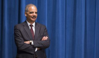 Attorney General Eric Holder smiles during a news conference at the Justice Department in Washington, Monday, Nov. 3, 2014. (AP Photo/Evan Vucci)