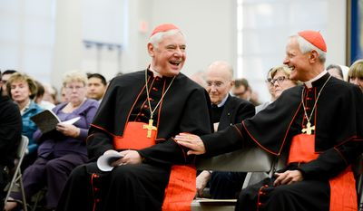 Cardinal Gerhard Ludwig MŸller, left, and Cardinal Donald Wuerl, right, share a laugh together before MŸller speaks at Catholic University, Washington, D.C., Monday, November 3, 2014. (Andrew Harnik/The Washington Times)