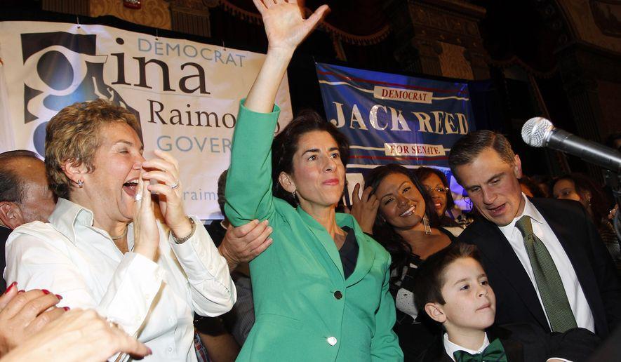 Democrat Gina Raimondo, center, celebrates her win over Republican Allan Fung in the Rhode Island governor's race, Tuesday, Nov. 4, 2014, in Providence, R.I. (AP Photo/Stew Milne)