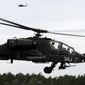 The AH-64D Apache attack helicopter is used mostly by the Army, but it also is found in other countries' military aviation fleets. (Associated Press) ** FILE **