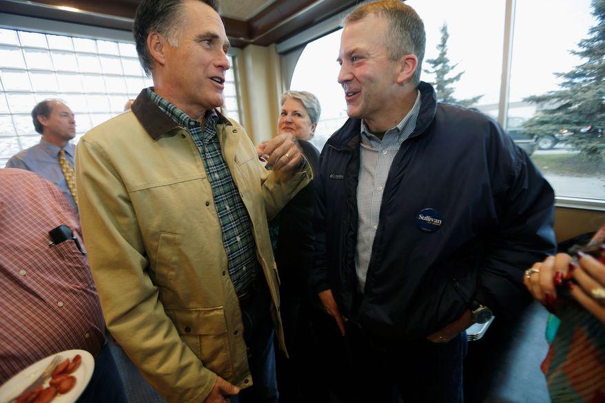 Alaska Republican Senate candidate Dan Sullivan (right), got some high-power backing from 2012 GOP presidential nominee Mitt Romney (left) at the City Diner in Anchorage, Alaska. Mr. Sullivan is challenging first-term Democratic Sen. Mark Begich. (Associated Press)