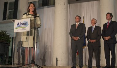 Kentucky Democratic Senate candidate Alison Lundergan Grimes gives her concession speech after losing her bid to unseat Senate Minorty Leader Mitch McConnell. (Associated Press photographs)