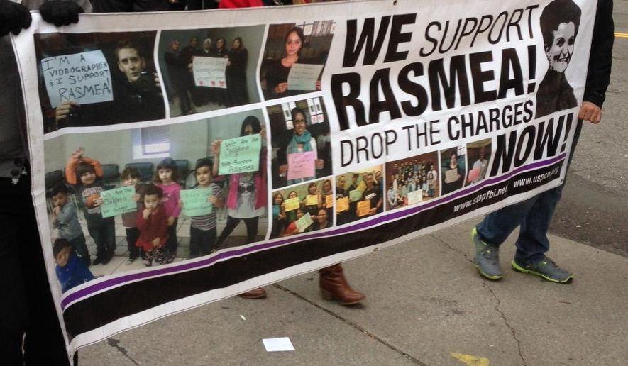 Rasmieh Odeh's supporters march outside the federal courthouse in Detroit, Tuesday, Nov. 4, 2014. Odeh, associate director at Chicago's Arab American Action Network, is charged with failing to tell U.S. immigration about her conviction for bombings in Israel in 1969, including one that killed two people at a supermarket. Odeh's trial began Tuesday. (AP Photo/Ed White)