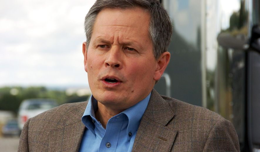 FILE - In this Aug. 25, 2014 photo U.S. Rep. Steve Daines, a first-term Montana Republican seeking election to the U.S. Senate, talks to media in Billings. Daines is facing Democrat Amanda Curtis in the Nov. 4 election.(AP Photo/Matthew Brown, File)