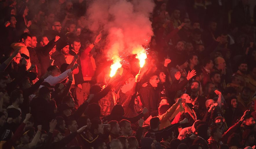 Galatasary supporters light fireworks during the Champions League group D soccer match between Borussia Dortmund and Galatasaray Istanbul in Dortmund, Germany, Tuesday, Nov.4, 2014. (AP Photo/Martin Meissner)