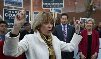 Massachusetts Democratic gubernatorial candidate Martha Coakley, left, raises her arms while speaking to a crowd as U.S. Sen Elizabeth Warren, D-Mass., right, and Democrat Seth Moulton, a candidate for the U.S. House of Representatives, second from right, look on during a campaign event, Monday, Nov. 3, 2014, in Lynn, Mass. (AP Photo/Steven Senne)