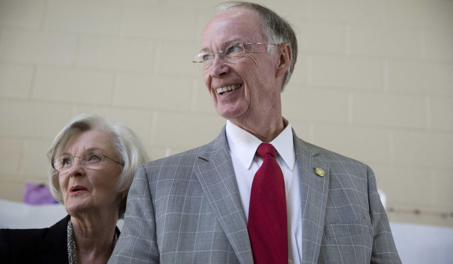 "Republican Gov. Robert Bentley smiles with his wife, Dianne Bentley, after voting booth on election day, Tuesday, Nov. 4, 2014, in Tuscaloosa, Ala. Bentley says he ""feels good"" about the governor race against Democratic challenger Parker Griffith. (AP Photo/Brynn Anderson)"