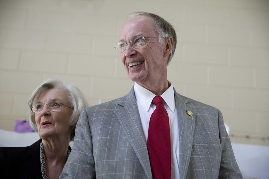 """Republican Gov. Robert Bentley smiles with his wife, Dianne Bentley, after voting booth on election day, Tuesday, Nov. 4, 2014, in Tuscaloosa, Ala. Bentley says he """"feels good"""" about the governor race against Democratic challenger Parker Griffith. (AP Photo/Brynn Anderson)"""