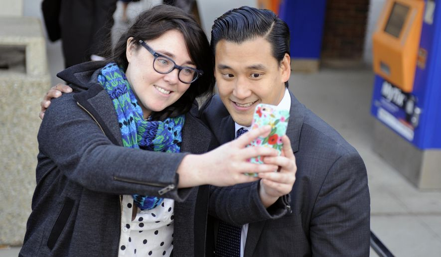 Landry Haarmann, of Ridgewood, N.J., takes a selfie with Roy Cho, candidate for U.S. congress in the 5th congressional district,  before Haarmann boarded her train on Election Day, Tuesday, Nov. 4, 2014, at the Ridgewood train station in  Ridgewood, N.J. (AP Photo/The Record of Bergen County, Amy Newman) ONLINE OUT; MAGS OUT; TV OUT; INTERNET OUT;  NO ARCHIVING; MANDATORY CREDIT