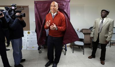 Sen. Cory Booker, D-N.J.,  applauds while exiting a voting booth after casting his vote in the 2014 general election, Tuesday, Nov. 4, 2014, in Newark, N.J.  Booker is going up against Republican challenger Jeff Bell. (AP Photo/Julio Cortez)