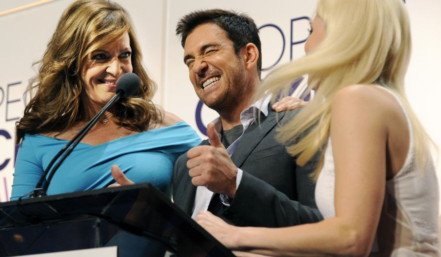 "Actor Dylan McDermott, center, a cast member in the television series ""Stalker,"" reacts between fellow presenters Allison Janney, left, and Anna Faris from the comedy series ""Mom"" as the show was nominated for Favorite New TV Drama during the nominations for the People's Choice Awards 2015 on Tuesday, Nov. 4, 2014, in Beverly Hills, Calif. The annual awards show will be held on Jan. 7, 2015 at the Nokia Theatre in Los Angeles. (Photo by Chris Pizzello/Invision/AP)"