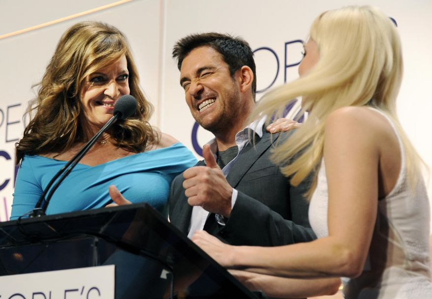 """Actor Dylan McDermott, center, a cast member in the television series """"Stalker,"""" reacts between fellow presenters Allison Janney, left, and Anna Faris from the comedy series """"Mom"""" as the show was nominated for Favorite New TV Drama during the nominations for the People's Choice Awards 2015 on Tuesday, Nov. 4, 2014, in Beverly Hills, Calif. The annual awards show will be held on Jan. 7, 2015 at the Nokia Theatre in Los Angeles. (Photo by Chris Pizzello/Invision/AP)"""