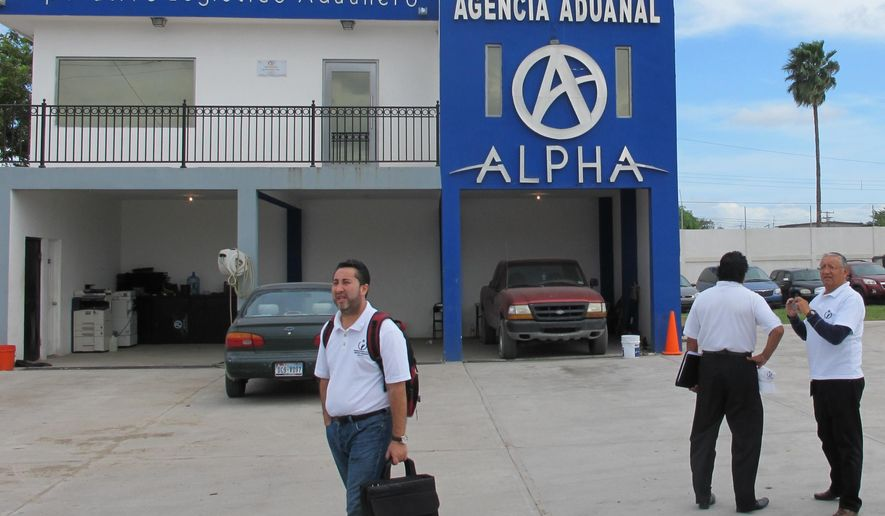 Investigators from the Mexican National Human Rights Commission arrive at the Alpha import car lot in Matamoros, Mexico on Tuesday, Nov. 4, 2014. Investigators interviewed employees at an import car lot  where the parents of three young Americans shot to death in Mexico say they found their vehicles. (AP Photo/Christopher Sherman)