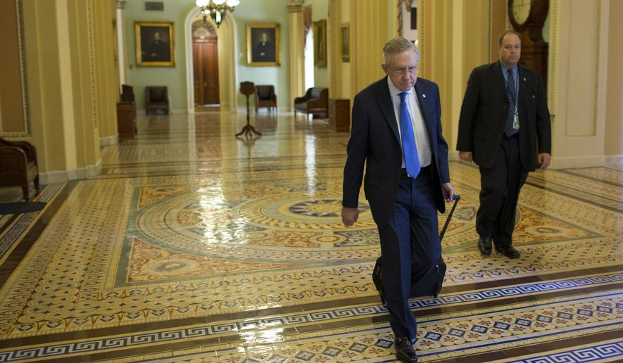 Senate Majority Leader Sen. Harry Reid, D-Nev., walks to his office after arriving on Capitol Hill on Monday, Oct. 14, 2013 in Washington. The federal government remains partially shut down and faces a first-ever default between Oct. 17 and the end of the month. (AP Photo/ Evan Vucci)