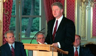 "President Clinton speaks after the signing of the Balkan peace treaty at the Elysee Palace in Paris, Dec. 14, 1995. Clinton called it the day that turned the shattered country ""from the horror of war to the promise of peace.'' (AP Photo/Michel Gangne/pool)"