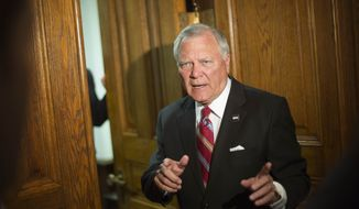 Georgia Gov. Nathan Deal tells members of the media he'll return in a moment to answer questions as heads into his office after a news event for an economic development announcement at the State Capitol, Monday, Nov. 3, 2014, in Atlanta. (AP Photo/David Goldman)