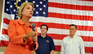Shelley Moore Capito speaks during a campaign rally in Beckley, W.Va., as state Sen. Evan Jenkins and former Massachusetts Gov. Mitt Romney look on. West Virginia has been trending Republican for more than a decade and voted Republican in every presidential election since 2000, but both of its U.S. senators were Democrats before Ms. Capito's victory in the midterm elections. (AP Photo/Chris Tilley)