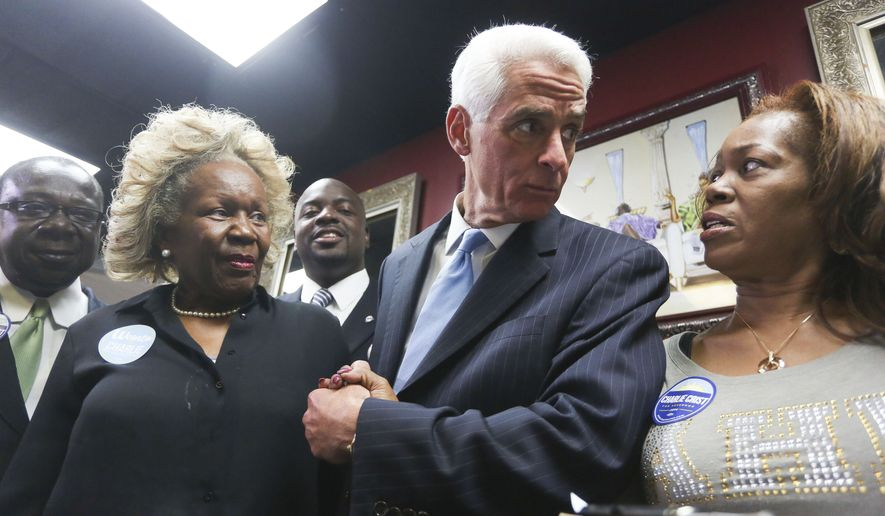 From left to right, M.A. Judge, Charlie Crist and Celeste Johnson talk during a campaign visit at Total Image Beauty Salon in Tampa, Tuesday, Nov. 4, 2014. (AP Photo/The Tampa Bay Times, Eve Edelheit)  TAMPA OUT; CITRUS COUNTY OUT; PORT CHARLOTTE OUT; BROOKSVILLE HERNANDO TODAY OUT