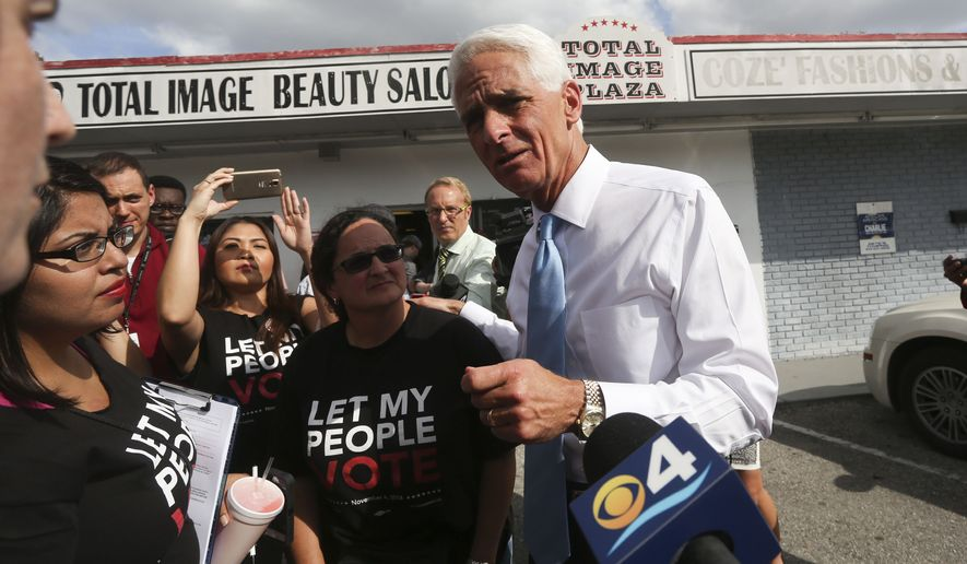 Charlie Crist talks to Denise Collazo during a campaign visit at Total Image Beauty Salon in Tampa, Tuesday, Nov. 4, 2014. (AP Photo/The Tampa Bay Times, Eve Edelheit)  TAMPA OUT; CITRUS COUNTY OUT; PORT CHARLOTTE OUT; BROOKSVILLE HERNANDO TODAY OUT