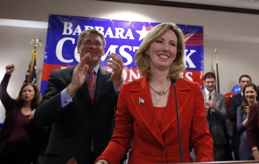 Virginia Republican Congressional candidate Barbara Comstock, right, celebrates with her husband Chip Comstock, at her election night party, Tuesday, Nov. 4, 2014 in Ashburn, Va. Comstock ran against democrat John Foust for the 10th Congressional District of Virginia. (AP Photo/Alex Brandon)