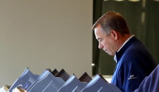 U.S. House Speaker John Boehner casts his vote at VOA Park in West Chester, Ohio, on Election Day, Tuesday, Nov. 4, 2014. (AP Photo/The Cincinnati Enquirer, Cara Owsley)