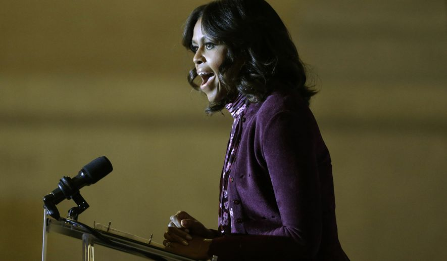 First lady Michelle Obama campaigns for Maryland Democratic gubernatorial candidate, Lt. Gov. Anthony Brown, during a get-out-the-vote rally, Monday, Nov. 3, 2014, in Baltimore. Maryland voters will choose a successor to Maryland Gov. Martin O'Malley, Tuesday. (AP Photo/Patrick Semansky)