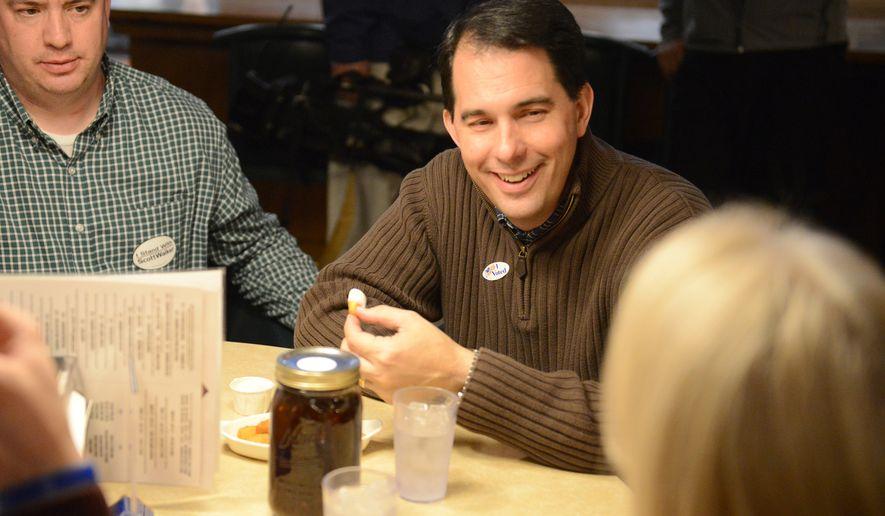 Wisconsin Gov. Scott Walker makes a campaign stop at Kroll's West in Ashwaubenon, Wis., on Election Day, Tuesday, Nov. 4, 2014. (AP Photo/The Green Bay Press-Gazette, H. Marc Larson) NO SALES
