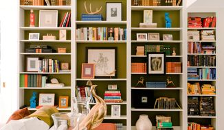 In this photo provided by M. Design Interiors, framed art is displayed both in and on a built-in bookcase. The effect is open and airy, while still providing ample storage space for the homeowner's book collection. The interior and bookcase design is by Molly Luetkemeyer. (AP Photo/M. Design Interiors, Justin Officer)