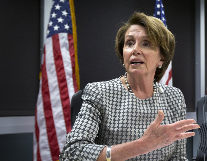 House Minority Leader Nancy Pelosi, of California, talks as she and Rep. Steve Israel, D-N.Y., chairman of the Democratic Congressional Campaign Committee receive updates of Election Eay information from Greg Jackson, field director of Democratic Congressional Campaign Committee at the Democratic Party headquarters in Washington, Tuesday, Nov. 4, 2014. (AP Photo/Manuel Balce Ceneta)
