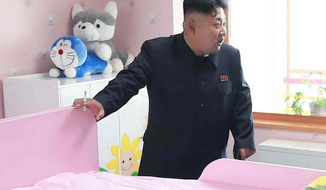 Perhaps one of the bravest pranksters of all time staged two stuffed animals performing sex acts in the background of a Kim Jong-un propaganda photo. (KCNA via Metro.uk)