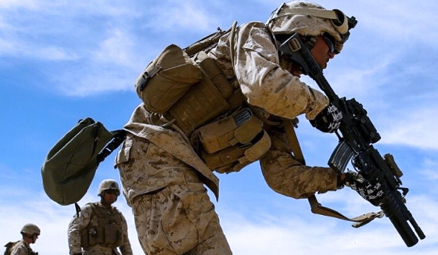 A Marine with Company F, 4th Light Armored Reconnaissance Battalion, sprints to his next position during a live-fire exercise at the Army National Training Center Fort Irwin, California, July 13, 2014. (U.S. Marine Corps)