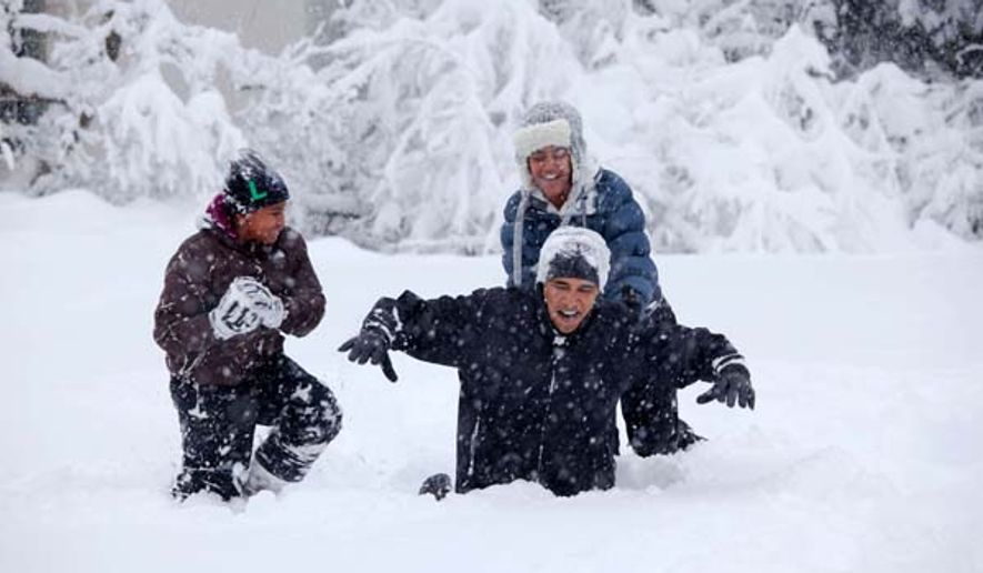 President Obama plays with his daughters in the Rose Garden during a 2010 snow storm. (White House photo)