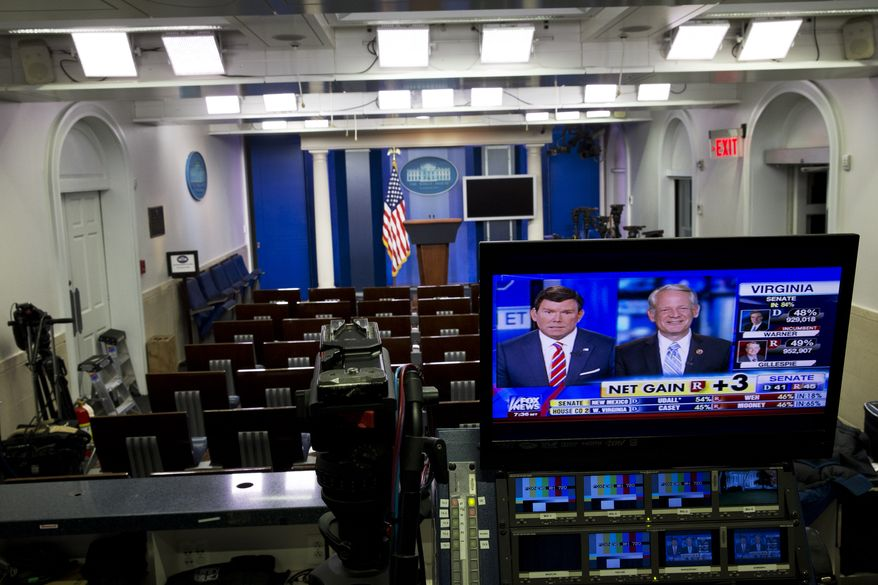 Fox News reports Republican gains in the Senate in an empty White House briefing room as poll numbers begin to pour in on election day, Tuesday, Nov. 4, 2014, in Washington. (AP Photo/Jacquelyn Martin)