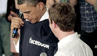 President Obama is given a Facebook sweatshirt by founder Mark Zuckerberg at an event in Silicon Valley, Calif., April 21, 2011. (Associated Press)
