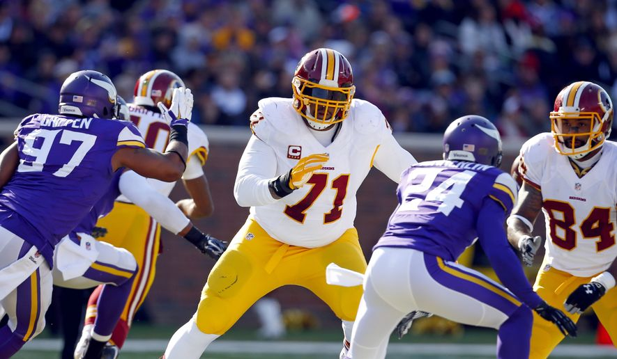 Washington Redskins tackle Trent Williams (71) looks to block against the Minnesota Vikings during an NFL football game, Sunday, Nov. 2, 2014, in Minneapolis. (Jeff Haynes/AP Images for Panini)