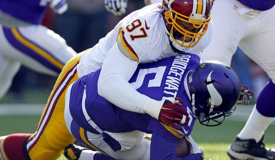 Washington Redskins defensive end Jason Hatcher (97) sacks Minnesota Vikings quarterback Teddy Bridgewater during an NFL football game, Sunday, Nov. 2, 2014, in Minneapolis. (Jeff Haynes/AP Images for Panini)